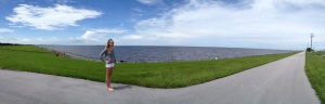 My niece Evie stands at the manicured edge of the east side of Lake Okeechobee at Port Mayaca. (Photo Jacqui Thurlow-Lippisch 2013)