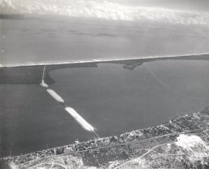 The Jensen Beach Bridge's causeway, built in 1957-58, as all causewayed bridges to the sea, severely blocked the slow flow of the Indian River Lagoon impacting the health of the river. (Photo courtesy archives of Sandra Henderson Thurlow.)