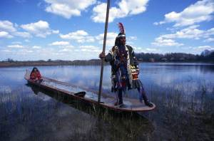 Florida Memory Project. Artist unlisted/subject Seminoles on dugout canoe,  near Lake Okeechobee.