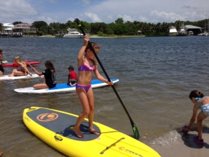 River Kidz member Mary paddle boards at Paddlefest 2013.