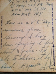 Writing on back of post card sent to Jensen Beach from Germany as a V.E. Day souvenir.