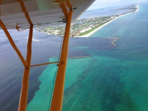 C-44, C-23 and C-24 basin runoff discolor the waters of the SLR/IRL while exiting the St Lucie Inlet 7-19-14. (Aerial photo, Ed Lippisch.)