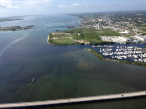"Aerial photo of C-25 canal carrying what DEP and SFWMD district note as ""nutrients and agriculture chemicals to the Indian River Lagoon."" (Photo Ed Lippisch, July 10, 2014.)"