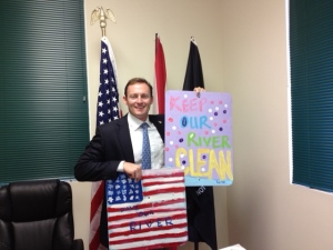 A newly elected Congressman Partick Murphy holding recycled FDOT signs painted by the River Kidz. The flag sign was taken to Washington DC and displayed in the front office, 2012.