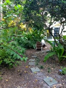 Back yard where grass was removed and repaved with stepping stones and Florida Friendly plants.