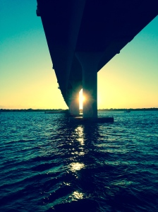 Every day the lone boulder watches the sun set over the Indian River Lagoon and peak through the Ernest Lyons Bridge.