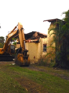 The wrecking ball takes the old house down...12-7-14. (Photo JRL)