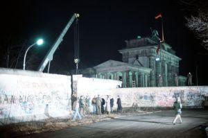 Crane taking down the Berlin Wall near 1990. (Public photo)