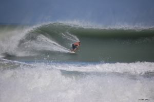 Evan Miller surfing, Facebook photo.