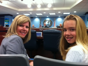 River Kidz co-founder, Evie Flaugh sits with her mother, Jenny, preparing to speak before the Martin County Commission, 2011.