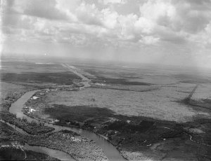 Ca. 1920s, looking west one sees the straight C-44 canal then known as the St Lucie Canal, and its connection to the South Fork of the St Lucie River. (Aerial  Thurlow Archives)