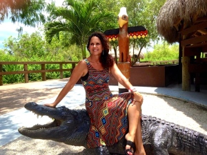 Me sitting atop a gator statue while visiting Miccosoukee Tribe of Indians, Florida. (Photo Ed Lippisch, 2014.)