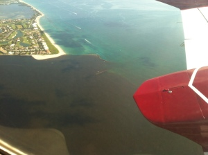 Cessna 340 June 28th 2014 photo showing plume from area canals and Lake Okeechobee exiting St Lucie Inlet.