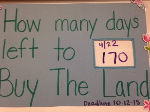 Sign on board wit land purchase south of the lake deadline for the state legislature, 2015.