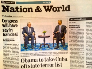 Inside page of Stuart News, US President Obama meets with Raul Castro, Fidel Castro's brother, 4/2015.)