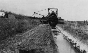 Drainage canal being dredged Davie 11913.