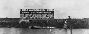 Sign with Seminole in canoe 1913, Tamiami Trail. (Public photo)