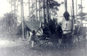 The J.J. Pichford Family camping at Cane Slough ca. 1918. (Archives, historian, Sandra Thurlow.) photo copy courtesy of Sandra Henderson Thurlow.