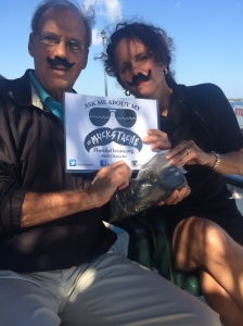 "Mark Perry and I display our ""muckstaches"" for Florida Oceanographics fundraiser/awareness raiser, 2015."