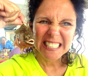 Me holding up a fried piranha Ed and I caught recently on a trip to Peru.  (Photo Ed Lippisch 2015.)