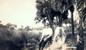"""Man next to artesian well, IRL. """"Mr Doug Witham allowed me to copy this photograph he purchased over eBay. It is of an unidentified man in St. Lucie Gardens. That is the huge subdivision of land Sir. Edward Reed purchased from Hamilton Disston. Since the notation on the back was written at Walton it is probably some place pretty close to the Indian River Lagoon. Sandra H.Thurlow 8-15)---Used with permission/purchased on Ebay by Doug Whitam and shared via Sandra Henderson Thurlow."""