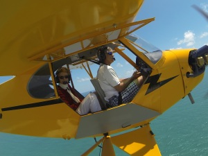My mother, Sandy Thurlow, flying in the cub with Ed. 2014. Go Pro photo.