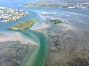 Aerial confluence of St Lucie River/Indian River Lagoon and St Lucie Inlet with low tide exposed sea grasses looking bleak. (Photo Ed Lippisch; plane piloted by Scott Kuhns 8-20-15.)