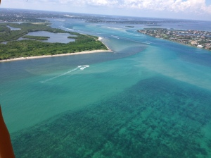 Weak rain plume exiting SL Inlet with near shore reefs in clear view through clear ocean water. 8-24-15. (Ed Lippisch)
