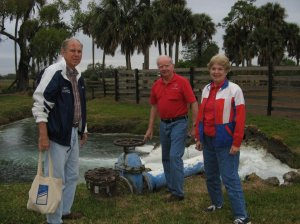 Artesian well on Bud Adam's Ranch in St Lucie Lucie County. Photo L to R Tom Thurlow, my father, and Dr and Mrs Powers long-time,good family friends. (Photo by Sandra Thurlow, ca early 2000.)