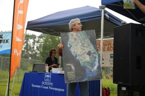 Leon Abood holds map of South Florida. Rally/protest St Lucie Locks and Dam 2103. (Photo Darrell Brant)