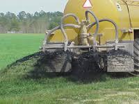 Public photo biosolids land application.