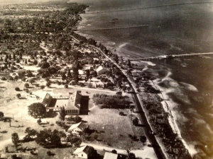"""1943 aerial photograph of the Jensen School and today's downtown Jensen with the wooden Jensen Bridge. As shown on page 20 of """"Historic Jensen Beach and Eden on Florida's Indian River,"""" by Sandra Thurlow-Henderson, 2004."""