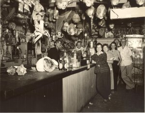 The crowd having fun surrounded by coconut herds at Pichford's Bar, Jensen Beach. Billy Pichford is behind the bar. (Photo shared by Bob Washam/info. from historian Sandra Thurlow)