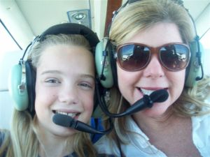 Evie and Jenny Flaugh during flight to Everglades with my husband Ed, 2012)