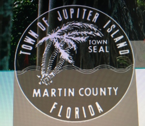 Town of Jupiter Island, palm tree and wavy waters.