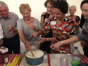 Making cheese at Ground Floor Farm in Stuart with hostess Lindsey Donigan, guests, and owner Jackie Vitale.