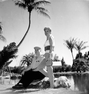 Frances Langford and Ralph Eventide photographed before their trademark Tiki Hut and pond, Jensen Beach Estate, 1961. (Photo Aurthur Ruhnke with permission of historian Sandra Henderson Thurlow)