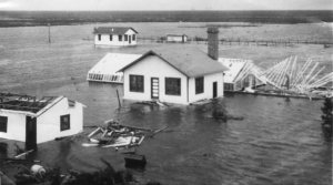 The Belle Glade Everglades experiment station after the hurricane of 1928. Palm Beach Post file photo BELLE GLADE --- An undated photo taken in the aftermath of the 1928 hurricane shows the damage done to a cluster of scientific work stations. Thousands drowned on Sept. 16 that year when hurricane-force winds blew a wall of water from Lake Okeechobee through a makeshift dike. The official death toll is 1,836, but historians and hurricane researchers say it's probably closer to 2,500 or 3,000. ORG XMIT: MER0503211643572784 ORG XMIT: MER0705171719342077