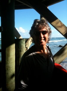 My husband Ed under the pier in 2009. The pier washed away a few years later after a great storm.